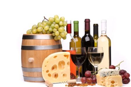 Wine composition. Barrel, grape, bottles, glasses, cheese. photo