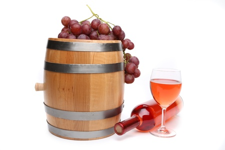 Wine composition. Barrel, grape, bottle and glass of wine. photo