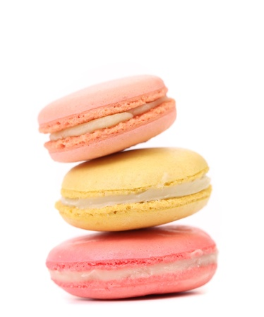 Stake of various  macaron cakes. White background. photo