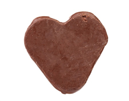 Close up of chocolate heart shape on a white background photo
