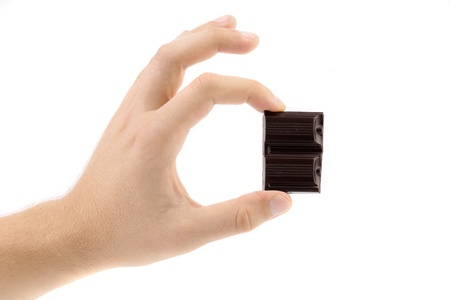 Hand holds chocolate bar  Close up  White background  Stock Photo - 21247585