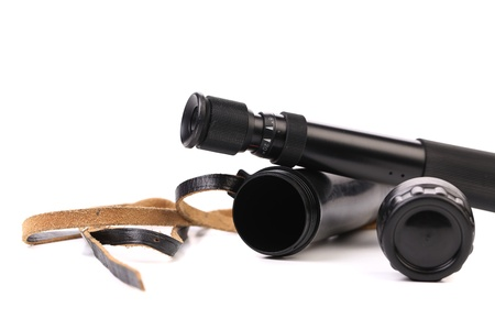 eyepiece: Black cover and spyglass lying on a white background