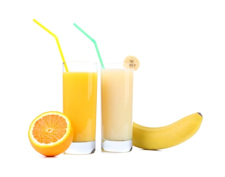 Juices of orange and banana. Fruits. White background. photo