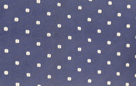 Background of blue tie with white speck. Texture. photo