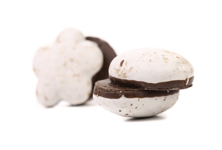 kiss biscuits: Several different chocolate meringues. Close up. White background.