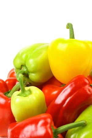 Multi-colour peppers on a white background. Close up. photo