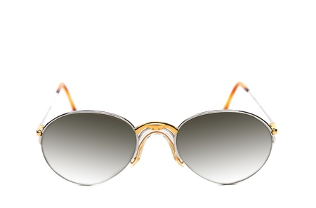 Sunglasses of yellow and white gold on a white background. photo