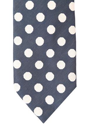 Polka dot necktie. Vertical. Close up. White background. photo