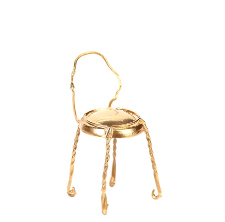 Golden chair from muzzle. Isolated on a white background. photo