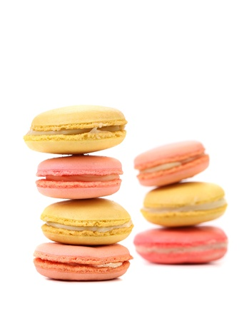 Stack of traditional French macarons against a white background. photo