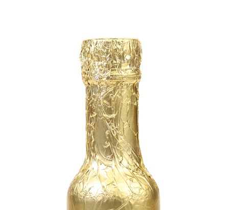 newyears: Bottle neck wrapped with gold foil. White background.