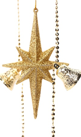 shinning light: Golden christmas star and bells. White background.
