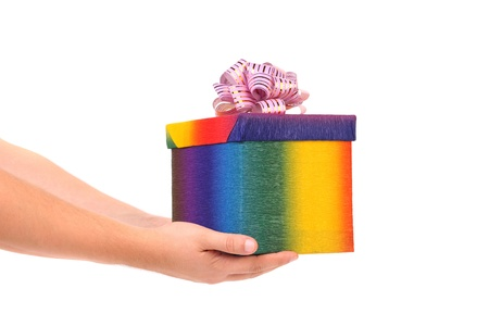 Colourful present box and pink bow. White background. photo
