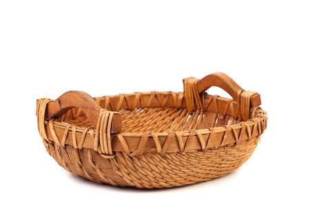 interleaved: vintage weave wicker basket isolated on a white background