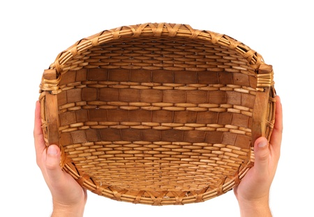 vintage weave wicker basket isolated on a white background photo