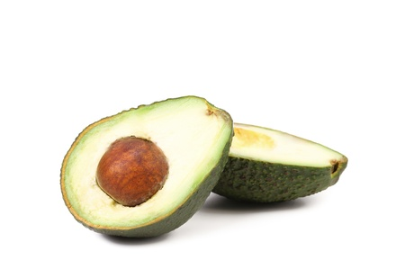 Splitted avocado. Isolated on a white background. photo