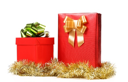 Two red boxes with bows and tinsel. White background. photo