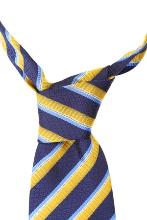 Knot of tie a colorful striped. White background. photo