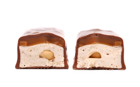 Slices bar of chocolate with filling. White background. photo