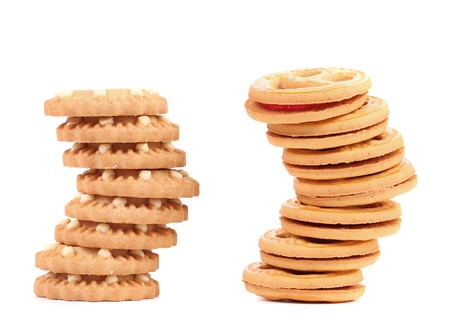 Stack of smile biscuits and another. White background. photo