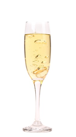 Wedding rings in a glass of champagne. White background. photo