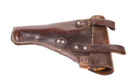 holster: Funda marr�n viejo aislado en un fondo blanco. Foto de archivo