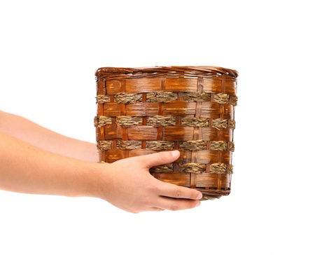 osier: Hand holds basket. Isolated on a white background. Stock Photo