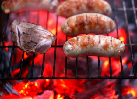 Meat and sausages on BBQ. Whole background. photo