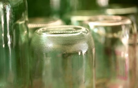 grooved: Grooved bottom of glass jar. Blurred background.