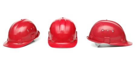 safety helmet: Three identical red hard hat. White background.