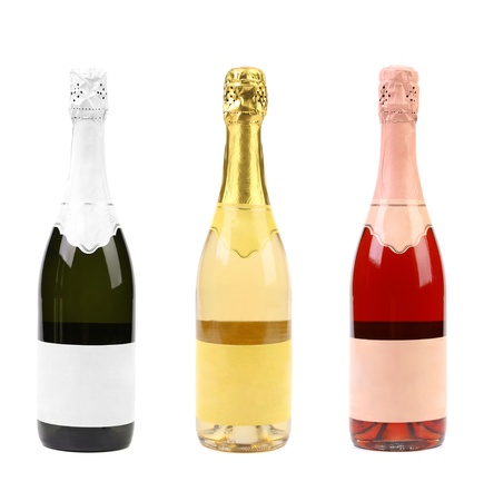 Three different bottles of champagne. White background. photo