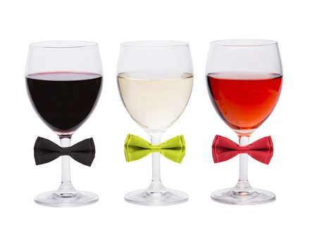 Three glasses of wine and bow tie. White background. photo
