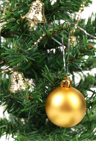 Background of christmas tree and yellow ball. Close up. photo