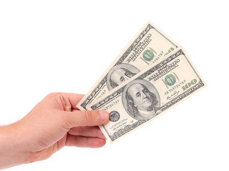Male hand holding american Dollar-bills. White background. photo