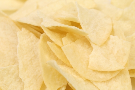 unhealthful: Background of potato chips. Close up. Texture.