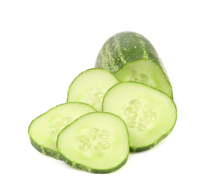 Fresh cucumber and slices. Isolated on a white background. photo