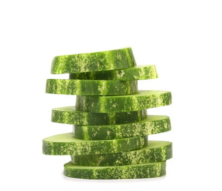 cuke: Stack of sliced fresh cucumbers. Isolated on a white background.