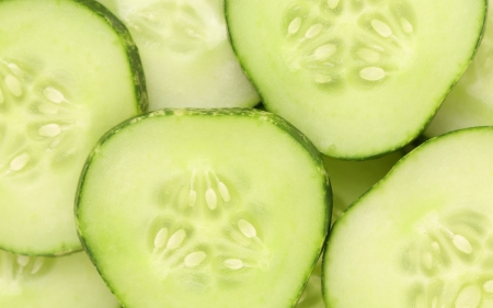 Background of sliced fresh cucumbers. Close up. photo