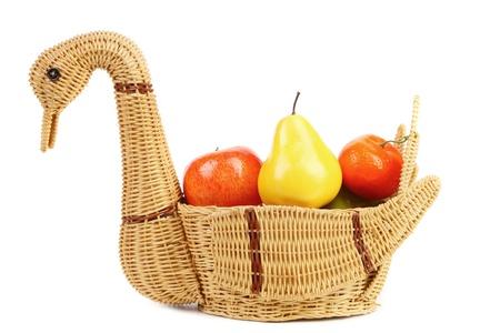 Basket swan with decorative fruits. White background. photo