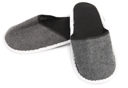 houseshoe: Pair of gray slippers on a white background. Close up.