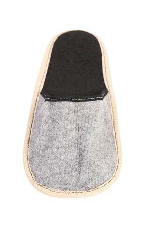 houseshoe: Gray slipper on a white background. Close up.