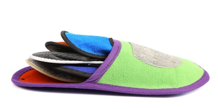 houseshoe: Colourful slippers into big slipper on a white background.