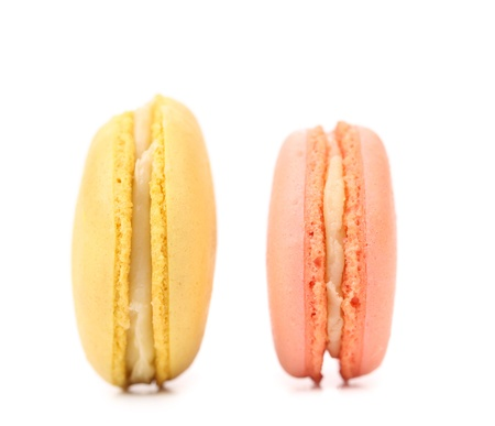 Two various macaron cakes with white cream photo