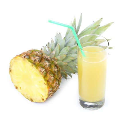 Glass of juice and pineapple isolated on white background photo