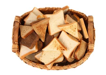 Full basket of different sliced ??bread. White background. photo