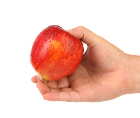 Hand holding a red apple with water dropets photo