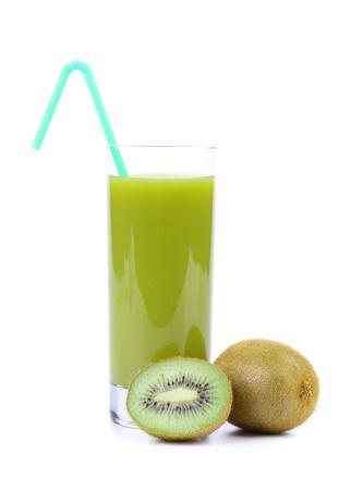 Kiwi juice and two kiwi cut and whole. photo