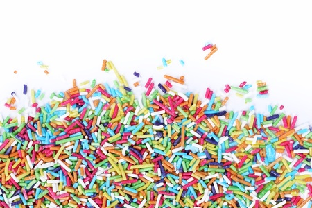 Colorful sugar sprinkles on a white background