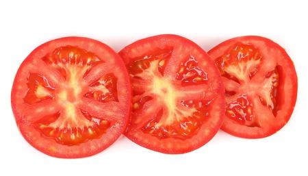 Tomato slice isolated on white background. Close up. Stock Photo