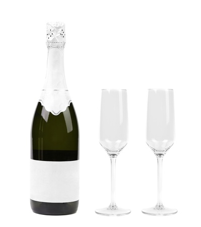 Champagne bottle and two glasses isolated on white photo